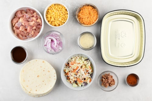 Home Chef Oven Kit Smoky BBQ Bacon Chicken Thigh Tacos With Cheddar Cheese Perspective: back