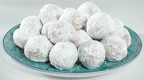 Bakery Fresh Powdered Sugar Cake Donut Holes Perspective: front