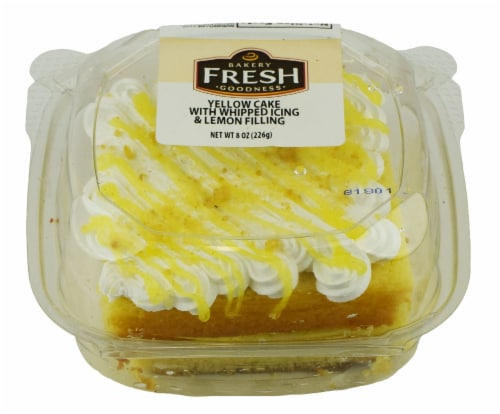 Bakery Fresh Goodness Yellow Cake with Whipped Icing & Lemon Filling Slice Perspective: front