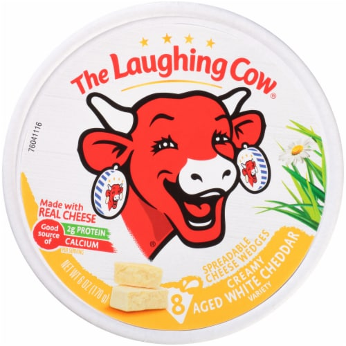 The Laughing Cow Creamy White Cheddar Flavor Spreadable Cheese Wedges Perspective: front