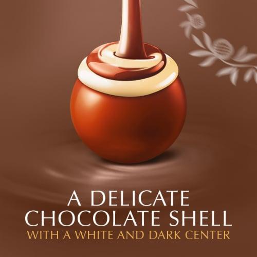 Lindt LINDOR Fudge Swirl Milk Chocolate Truffles Perspective: left