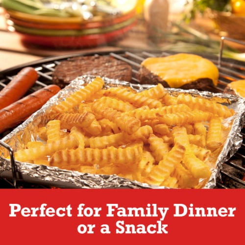 Ore-Ida Extra Crispy Seasoned Crinkles Fries Perspective: left