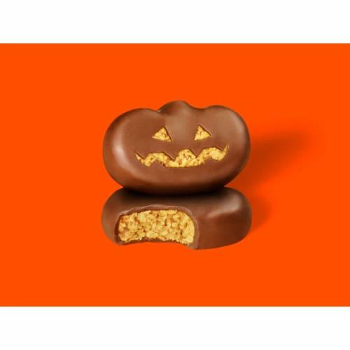 Reese's Peanut Butter Pumpkin Halloween Candy Perspective: left
