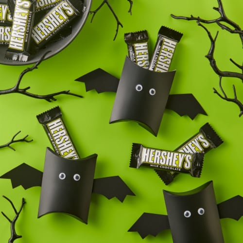 Hershey's Milk Chocolate Snack Size Halloween Candy Bars with Glow in the Dark Wrappers Perspective: left