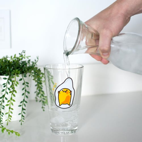OFFICIAL Gudetama Lazy Egg Glass | Feat. Gudetama Laying Face Up | 16 Oz. Cup Perspective: left