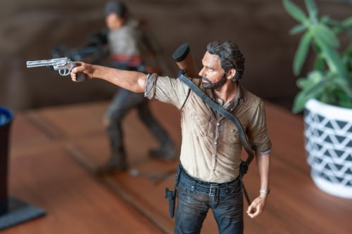 The Walking Dead Rick Grimes Deluxe Poseable Figure | Measures 10 Inches Tall Perspective: right