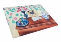 Carolines Treasures  7253LCB Fawn Pug reading in the kitchen Glass Cutting Board - 12Hx15W
